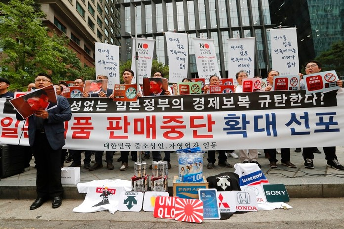 In this July 15, 2019, photo, South Korean small and medium-sized business owners stage a rally calling for a boycott of Japanese products in front of the Japanese embassy in Seoul, South Korea. (AP Photo/Ahn Young-joon)