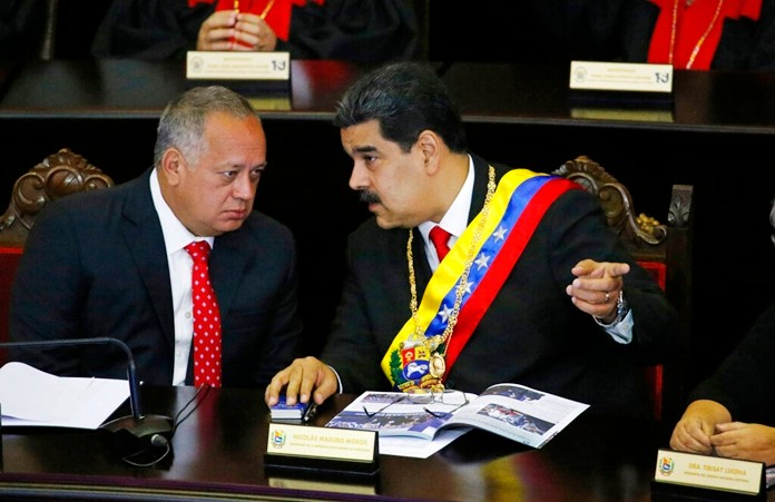 In this Jan. 24, 2019 file photo, Venezuelan President Nicolas Maduro, right, speaks with Constitutional Assembly President Diosdado Cabello at the Supreme Court during an annual ceremony that marks the start of the judicial year in Caracas, Venezuela. The U.S. has opened up secret communications with Cabello as members of Maduro's inner circle seek guarantees they won't face retribution if they cede to growing demands to remove him, a senior administration official told The Associated Press on Saturday, Aug. 17, 2019. (AP Photo/Ariana Cubillos, File)