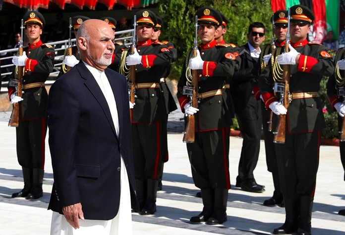 In this photo released by the Afghan Presidential Palace, Afghan President Ashraf Ghani inspects the honor guard during Independence Day celebrations at Defense Ministry in Kabul, Afghanistan, Monday, Aug. 19, 2019. (Afghan Presidential Palace via AP)