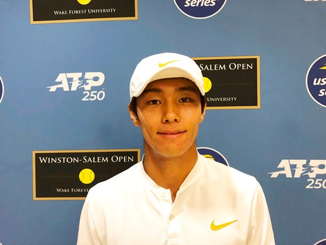 Tennis player Duckhee Lee, of South Korea, poses following his tennis match, Monday, Aug. 19, 2019, at the Winston-Salem Open in Winston-Salem, N.C. Lee became the first deaf professional to play in an ATP-level tennis tournament. (AP Photo/Joedy McCreary)