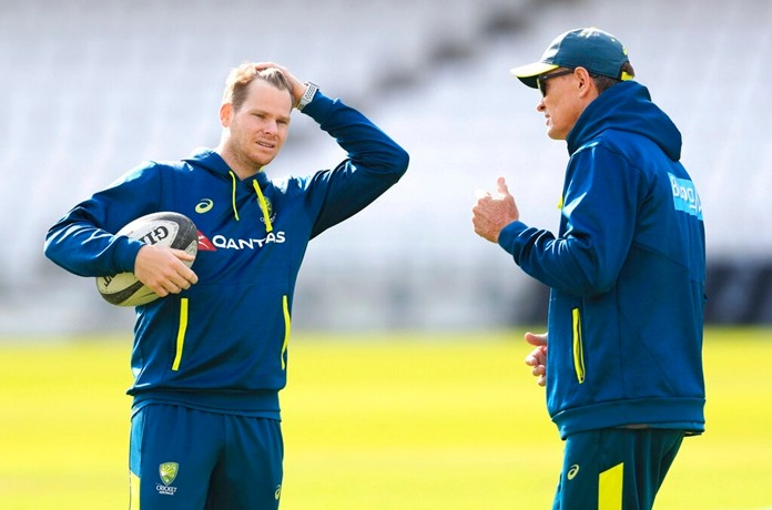 Australia's Steve Smith, left, speaks with Australia batting coach Graeme Hick during a nets session at Headingley, Leeds, England, Tuesday Aug. 20, 2019. England and Australia will begin the 3rd Ashes Test cricket match on Aug. 22. (Mike Egerton/PA via AP)