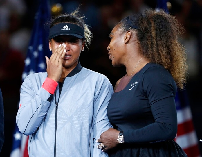 In this Sept. 8, 2018, file photo, Serena Williams talks with Naomi Osaka, of Japan, after Osaka defeated Williams in the women's final of the U.S. Open tennis tournament in New York. (AP Photo/Adam Hunger, File)