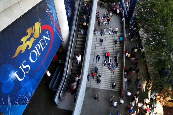 In this Sept. 3, 2017, file photo, tennis fans move in and out of Arthur Ashe Stadium during the fourth round of the U.S. Open tennis tournament in New York. How much does each first-round loser in singles at the U.S. Open take home in prize money? Who holds the women's record for most aces in the tournament? See how much you know about the year's last Grand Slam tennis tournament by taking the AP's U.S. Open quiz. (AP Photo/Frank Franklin II, File)