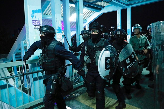 Riot police gather outside the Yuen Long MTR station during a protest in Hong Kong, Wednesday, Aug. 21, 2019. (AP Photo/Kin Cheung)