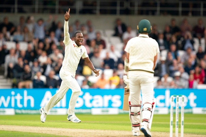 England's Jofra Archer celebrates after taking his 5th wicket, that of Australia's Pat Cummins, right, caught by Jonny Bairstow for 0 on the first day of the 3rd Ashes Test cricket match between England and Australia at Headingley cricket ground in Leeds, England, Thursday, Aug. 22, 2019. (AP Photo/Jon Super)