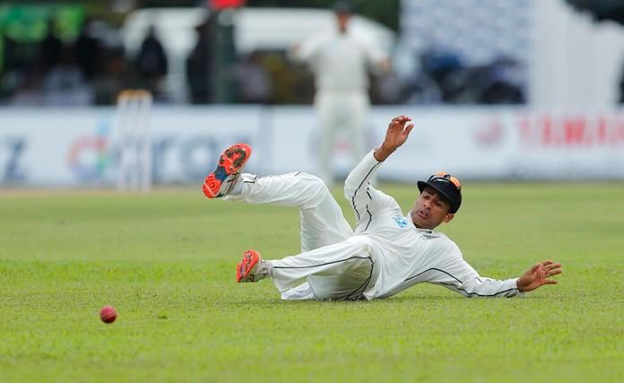 New Zealand's Jeet Raval misfields a ball during the first day of the second test cricket match between Sri Lanka and New Zealand in Colombo, Sri Lanka, Thursday, Aug. 22, 2019. (AP Photo/Eranga Jayawardena)
