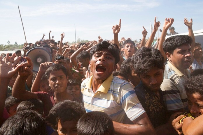 Rohingya refugees shout slogans during a protest against the repatriation process at Unchiprang refugee camp near Cox's Bazar, in Bangladesh Thursday, Nov. 15, 2018. (AP Photo/Dar Yasin, FILE)