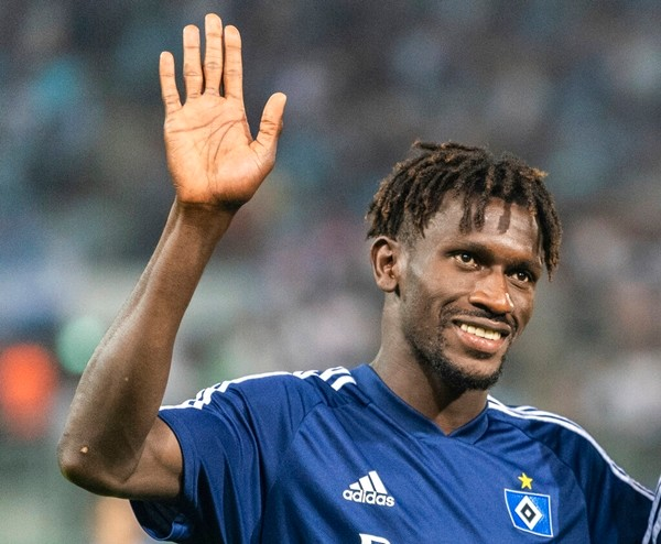 In this Aug. 11, 2019 file photo Hamurg's Bakery Jatta waves to fans after a match of Chemnitz against Hamburg in Chemnitz, Germany. (Robert Michael/dpa via AP)