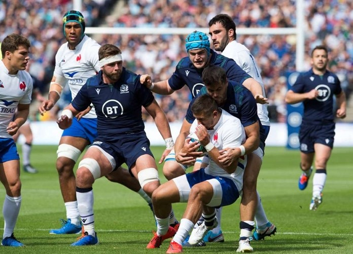 France's Thomas Ramos is tackled by Scotland's Sean Maitland and Scotland's Scott Cummings during the International Friendly rugby match between Scotland and France at the BT Murrayfield Stadium, Edinburgh, Scotland. Saturday Aug 24, 2019. (Ian Rutherford/PA via AP)