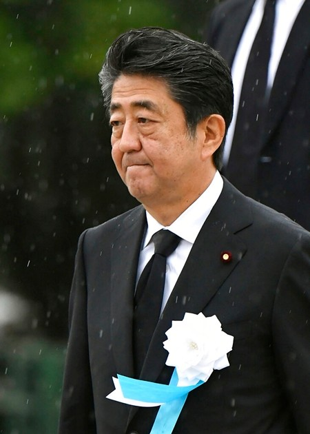 Japanese Prime Minister Shinzo Abe leaves after his speech during a ceremony to mark the 74th anniversary of the atomic bombing at the Hiroshima Peace Memorial Park in Hiroshima, western Japan Tuesday, Aug. 6, 2019. (Kyodo News via AP)