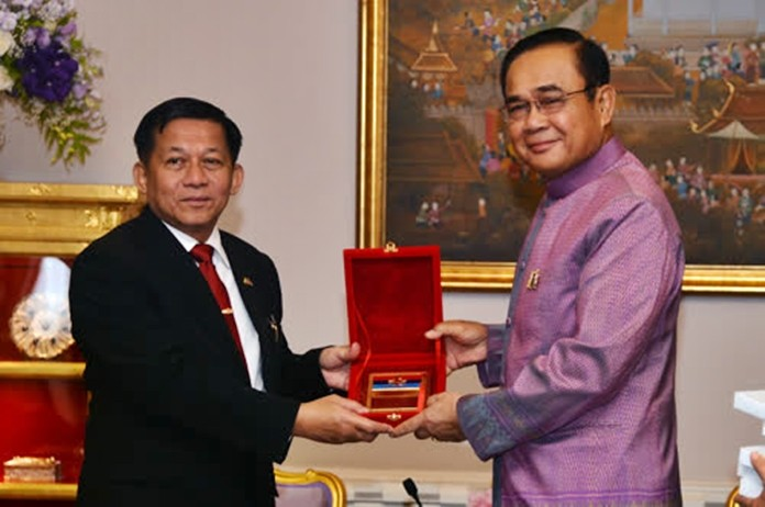 Myanmar's Supreme Commander, Gen. Min Aung Hlaing, left, is greeted by Thai Prime Minister Gen. Prayut in Bangkok, Tuesday, Sept. 3.