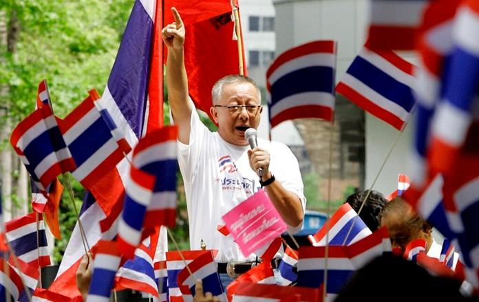 In this March 27, 2006, file photo, Sondhi Limthongkul addresses demonstrators in Bangkok. (AP Photo/Apichart Weerawong)