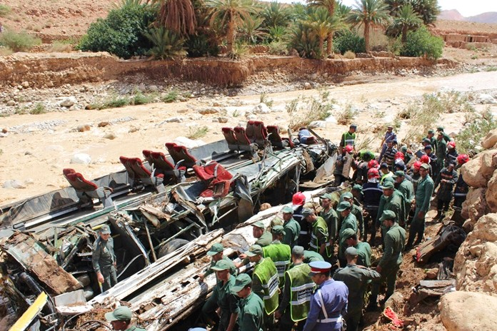 Security forces gather at the site of a bus crash in the town of Errachidia, Morocco, Sunday, Sept. 8, 2019. (AP Photo)