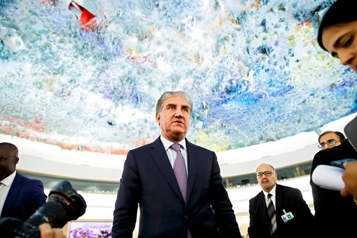 Pakistan's Foreign Minister Shah Mehmood Qureshi leaves after a statement during the 42nd session of the Human Rights Council at the European headquarters of the United Nations in Geneva, Switzerland, Tuesday, Sept. 10, 2019. (Salvatore Di Nolfi/Keystone via AP)