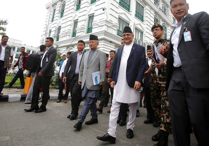 Prime Minister Khadga Prasad Oli, center right, leaves after inaugurating the Nepal-India cross border petroleum pipeline through video conference in Kathmandu, Nepal, Tuesday, Sept. 10, 2019. (AP Photo/Bikram Rai)