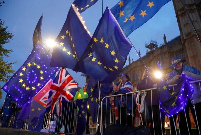 Pro EU protestors wave flags opposite parliament in London, Monday, Sept. 9, 2019. (AP Photo/Frank Augstein)