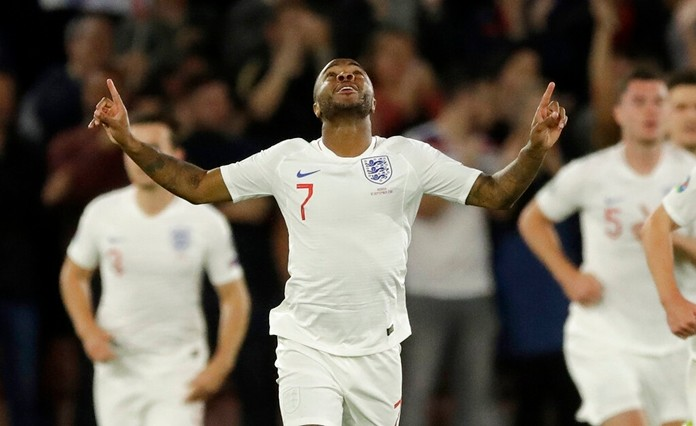 England's Raheem Sterling celebrates scoring his side's first goal during the Euro 2020 group A qualifying soccer match between England and Kosovo at St Mary's Stadium in Southampton, England, Tuesday, Sept. 10, 2019. (AP Photo/Matt Dunham)