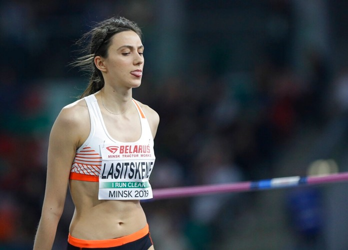 Mariya Lasitskene sticks her tongue out after a successful attempt in the women's high jump final during the Europe against USA athletics competition on the Dinamo stadium in Minsk, Belarus, Tuesday, Sept. 10, 2019. (AP Photo/Sergei Grits)