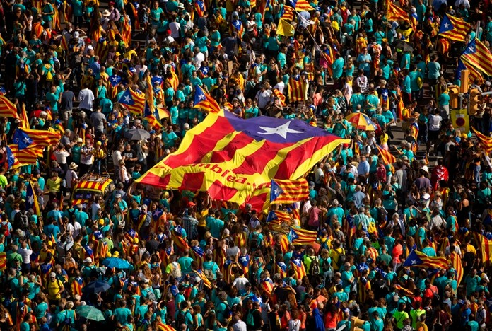 Protesters hold esteladas or independence flags as they take part in a demonstration during the Catalan National Day in Barcelona, Spain, Wednesday, Sept. 11, 2019. (AP Photo/Emilio Morenatti)