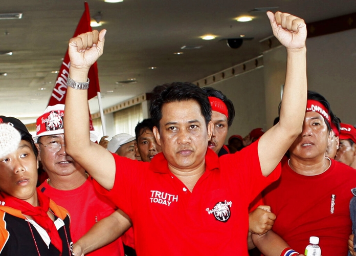 In this April 11, 2009, file photo, anti-government leader Arisman Pongruangrong is cheered as he and others march through the 14th ASEAN Convention Center at the Peach Conference Center, Royal Cliff Hotel in Pattaya. (AP Photo/David Longstreath)