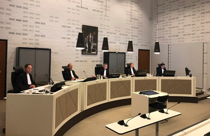 A judging panel presides in the court case for on a 74-year-old woman suffering from dementia who was euthanized three years ago despite some indications that she might have changed her mind, as the trial opens in The Hague, Netherlands Monday Aug. 26. The landmark euthanasia trial seeks to pinpoint what to do with dementia patients who have previously stated their wish to die under certain circumstances but later might have second thoughts. (AP Photo/Aleks Furtula)