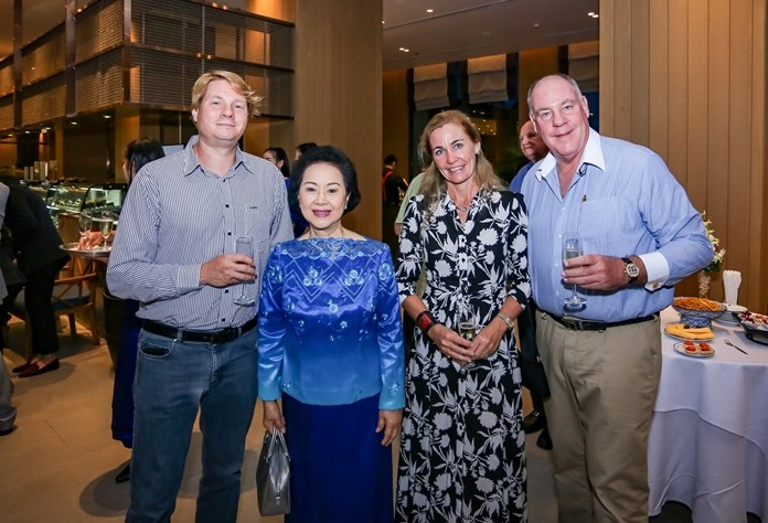 Mrs. Panga Vathanakul is flanked by Alexander Hutton (left) and Caroline Leib and Philippe Guenat of Bakri Cono Shipyard during the pre-dinner cocktail reception.