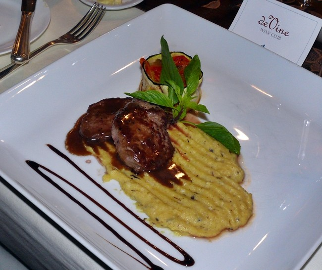 Veal scalopina with soft polenta, peperonata and Marsala sauce.
