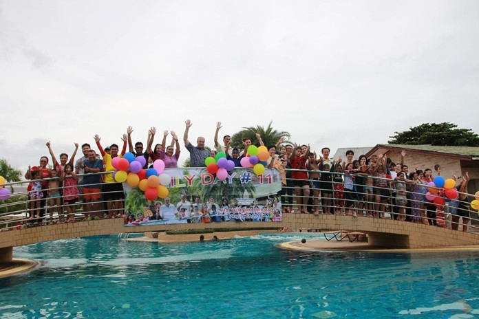 General Manager Rene Pisters (center) hosts Thai Garden Resort's 11th annual family day for employees.
