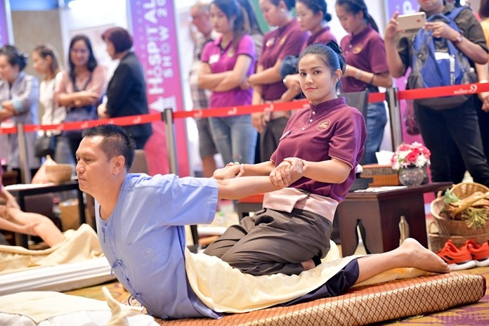 A visitor relaxes with a traditional Thai massage.