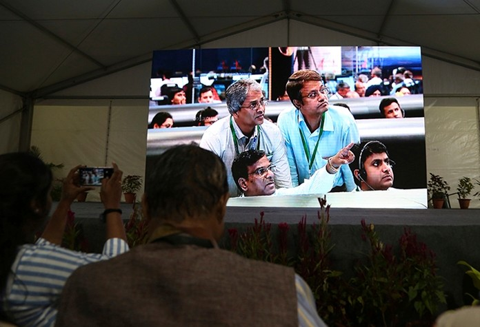 Live pictures of Indian Space Research Organization (ISRO) scientists reacting are displayed on a big screen at their Telemetry, Tracking and Command Network. (AP Photo/Aijaz Rahi)