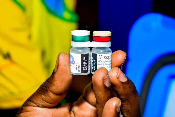 A health worker displays the new malaria vaccine in Homabay County, western Kenya, Friday, Sept. 13, 2019. The vaccine is the world's first for malaria and has been rolled out in Kenya, Ghana, and Malawi by the World Health Organisation. (AP Photo/Joseph Oduor)