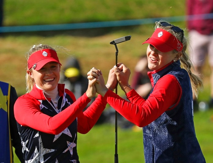 Sisters Nelly, left, and Jessica Korda of the US celebrate on the 14th after winning their Foursomes match 6 up during morning play of the Solheim Cup at Gleneagles, Scotland, Friday, Sept. 13, 2019. (AP Photo/Peter Morrison)