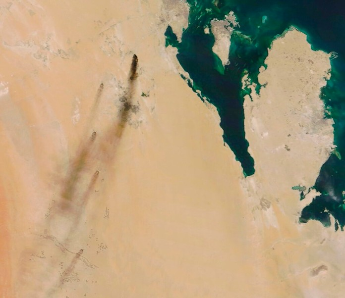 This Saturday, Sept. 14, 2019, satellite image shows fires following Yemen's Houthi rebels claiming a drone attack on two major oil installations in eastern Saudi Arabia. (NASA Worldview via AP)