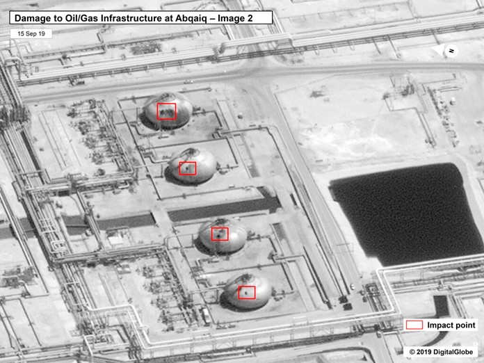 This image provided on Sunday, Sept. 15, 2019, by the U.S. government, shows damage to the infrastructure at Saudi Aramco's Abaqaiq oil processing facility in Buqyaq, Saudi Arabia. (U.S. government/Digital Globe via AP)