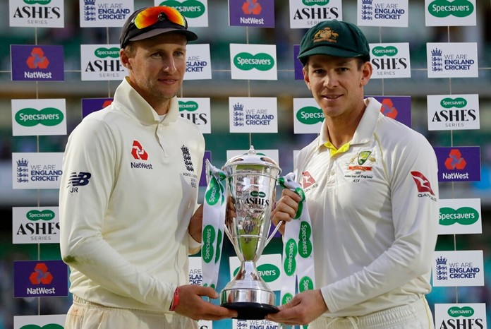 England's Joe Root, left, and Australia's Tim Paine hold the trophy during the presentation ceremony on the fourth day of the fifth Ashes cricket test match between England and Australia at the Oval cricket ground in London, Sunday, Sept. 15, 2019. England won the fifth test by 135 runs to draw the series but Australia retain the ashes trophy. (AP Photo/Kirsty Wigglesworth)