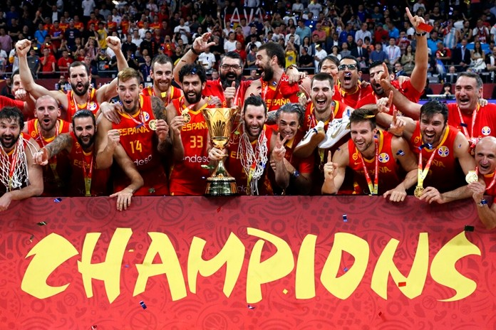 Members of Spain's team celebrate with the Naismith Trophy after they beat Argentina in the final of the FIBA Basketball World Cup at the Cadillac Arena in Beijing, Sunday, Sept. 15, 2019. (AP Photo/Mark Schiefelbein)