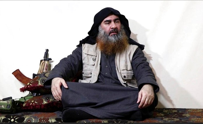 This file image posted on a militant website April 29, 2019, purports to show the leader of the Islamic State group, Abu Bakr al-Baghdadi, being interviewed by his group's Al-Furqan media outlet. (Al-Furqan media via AP)