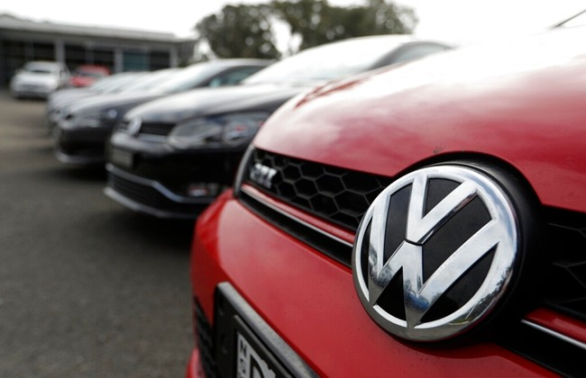 Display cars are parked at a Volkswagen dealership in Sydney, Monday, Sept. 16, 2019. (AP Photo/Rick Rycroft)