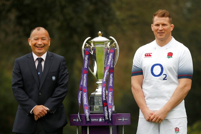 In this Jan. 24, 2018 file photo, England rugby team coach Eddie Jones and captain Dylan Hartley, right, pose for photographers with the trophy during the Rugby 6 Nations tournament launch in London. (AP Photo/Frank Augstein)