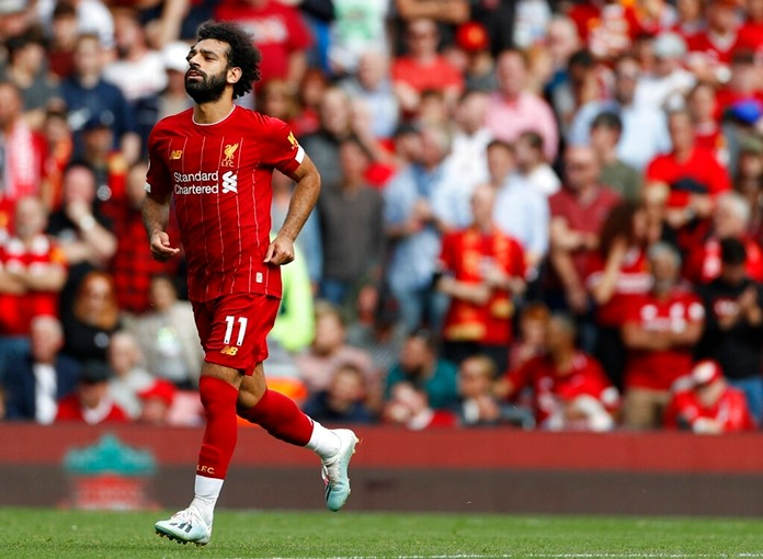 Liverpool's Mohamed Salah celebrates after scoring his side's third goal during the English Premier League match against Newcastle at Anfield stadium in Liverpool, Saturday, Sept. 14, 2019. (AP Photo/Rui Vieira)