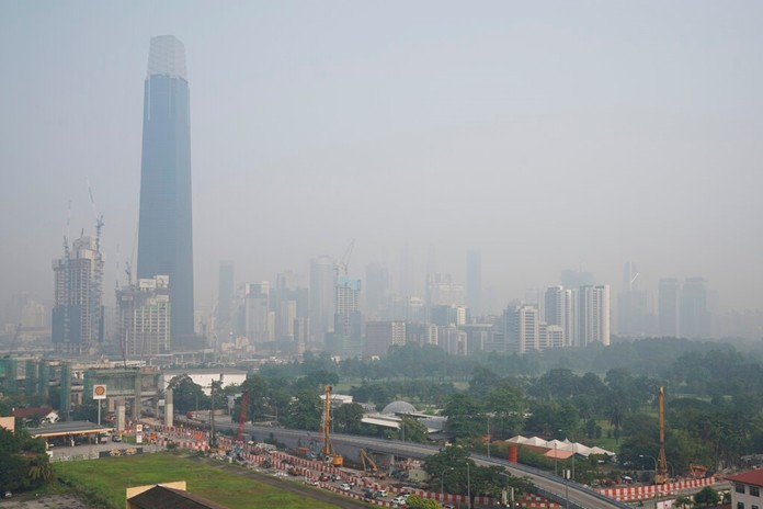 Kuala Lumpur city is shrouded with haze in Kuala Lumpur, Malaysia, Tuesday, Sept. 17, 2019. More than 100 schools were closed Tuesday after the air quality in the area continued to trend at very unhealthy levels. (AP Photo/Vincent Thian)