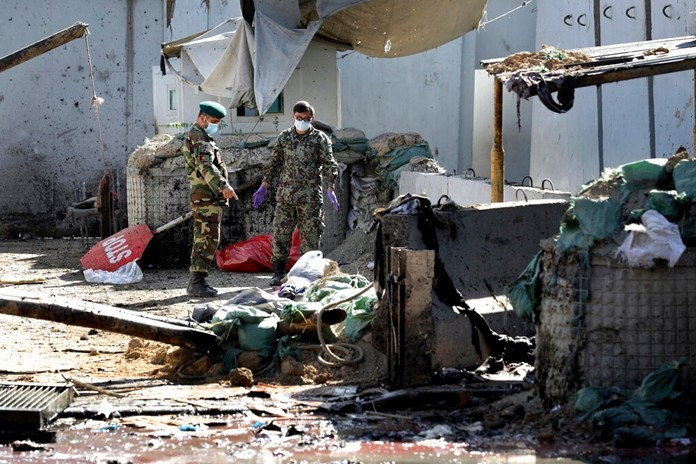 Afghan security forces work at the site of a suicide attack near the U.S. Embassy in Kabul, Afghanistan, Tuesday, Sept. 17, 2019. Hours earlier Afghan officials said a suicide bomber rammed his motorcycle packed with explosives into the entrance to a campaign rally of President Ashraf Ghani in northern Parwan province, killing over 20 people and wounding over 30. (AP Photo/Ebrahim Noroozi)