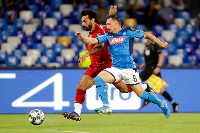 Liverpool's Mohamed Salah, left, and Napoli's Mario Rui fight for the ball during the Champions League Group E soccer match between Napoli and Liverpool, at the San Paolo stadium in Naples, Italy, Tuesday, Sept. 17, 2019. (AP Photo/Gregorio Borgia)