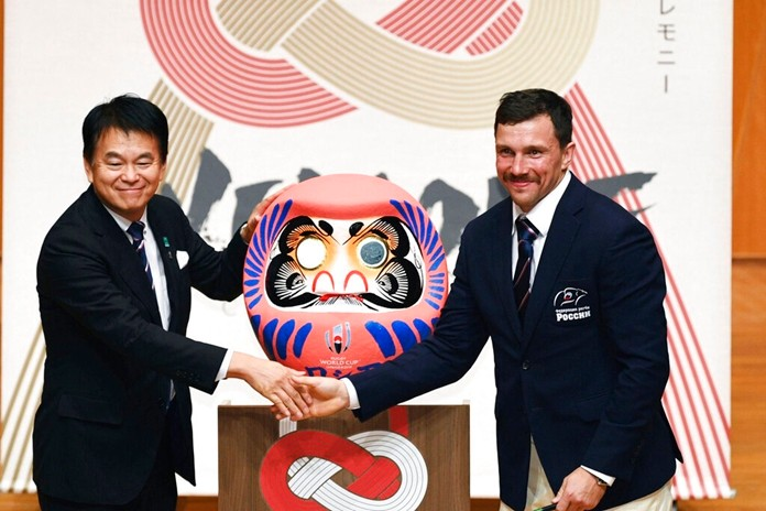 Russian rugby team's Vasily Artemyev, right, attends a welcome ceremony in Saitama, near Tokyo, Saturday, Sept. 14, 2019, ahead of the Rugby World Cup. At left is Saitama mayor Hayato Shimizu. (Kyodo News via AP)