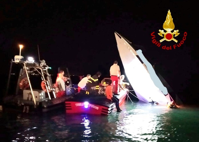 This image provided by firefighters shows the wreckage of a racing boat that allegedly smashed into a dam at the entrance of the Venice laguna, Italy, late Tuesday, Sept. 17, 2019. (Italian Firefighters via AP)