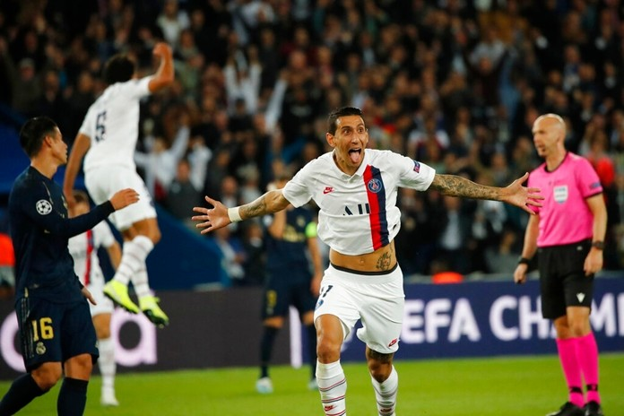 PSG's Angel Di Maria celebrates after scoring his side's second goal during the Champions League group A soccer match between PSG and Real Madrid at the Parc des Princes stadium in Paris, Wednesday, Sept. 18, 2019. (AP Photo/Francois Mori)