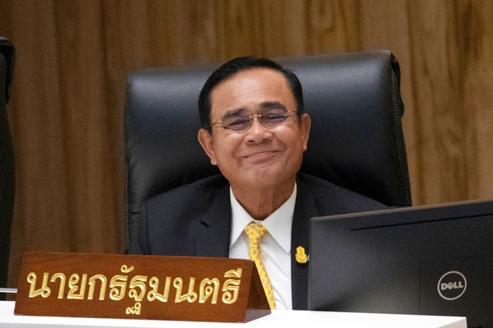 Prime Minister Prayuth Chan-ocha smiles before answering a question at parliament in Bangkok, Wednesday, Sept. 18, 2019. (AP Photo/Sakchai Lalit)