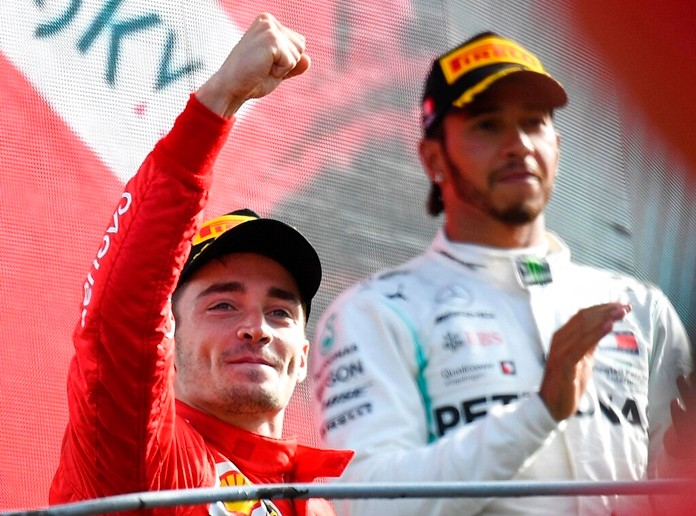 Ferrari driver Charles Leclerc of Monaco, left, celebrates with third placed Mercedes driver Lewis Hamilton of Britain, on the podium after winning the Formula One Italy Grand Prix at the Monza racetrack, in Monza, Italy, Sunday, Sept.8, 2019. (AP Photo/Antonio Calanni) (Daniel Dal Zennaro/ANSA Via AP)