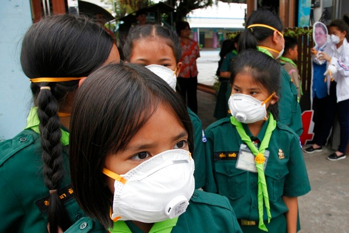 Thai students wear protective masks at Boonlert Anusorn school in Songkhla province, southern Thailand, Thursday, Sept. 19, 2019. (AP Photo/Sumeth Panpetch)