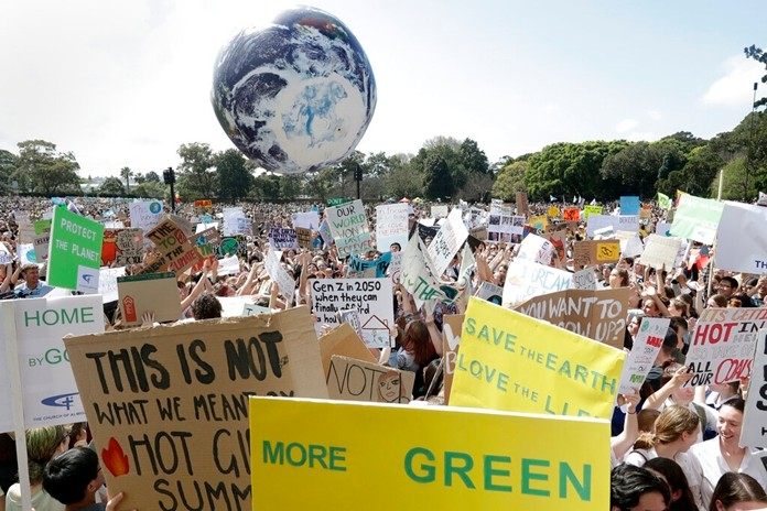 Thousands of protestors, many of them school students, gather in Sydney, Friday, Sept. 20, 2019, calling for action to guard against climate change. (AP Photo/Rick Rycroft)